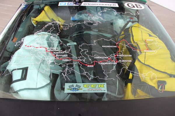 Route map is stuck on the rear windscreen showing the golf courses they played on